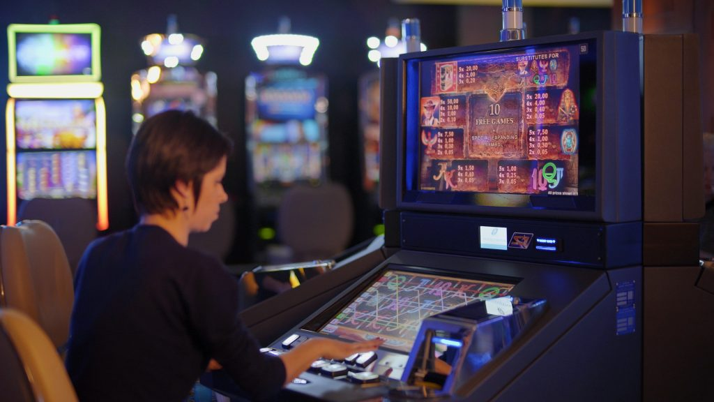 Woman Playing Free Games on a Slot Machine